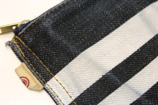 Momotaro coin purse frontal closeup